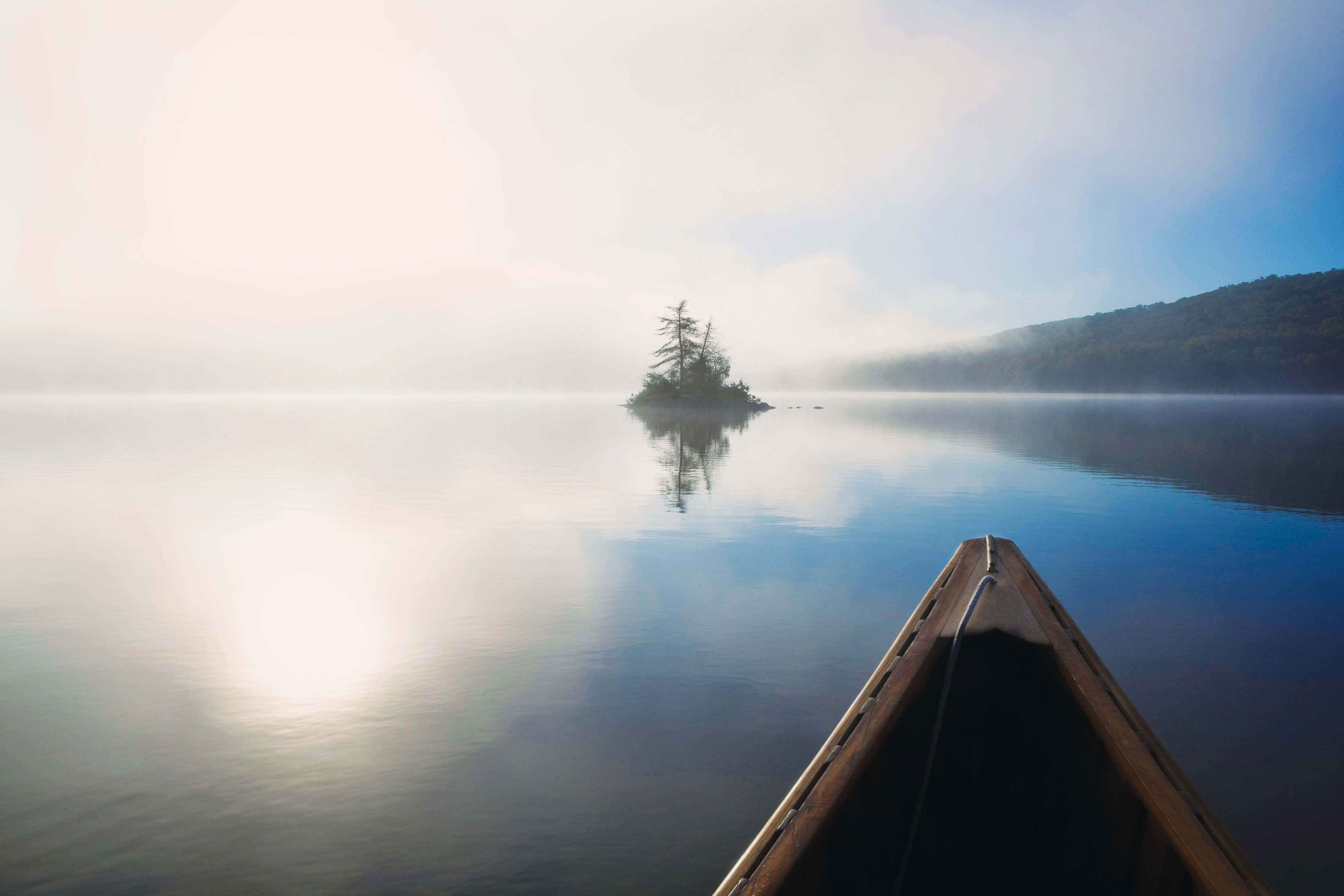 Canoe on misty lake