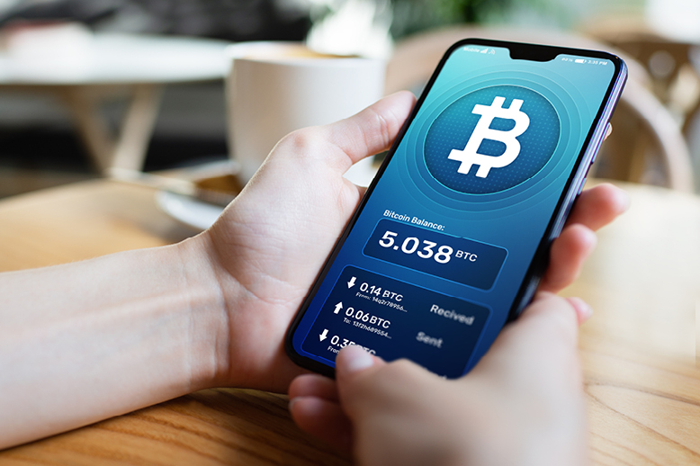 close view hands holding mobile phone with bitcoin app in page