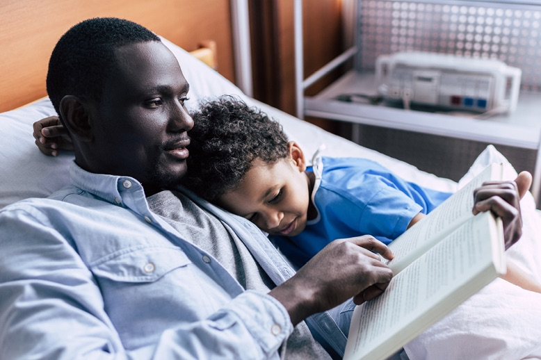 father-and-son-reading-book-together-in-page