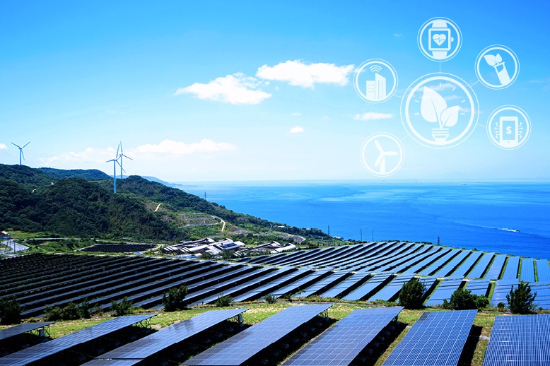 hilltop-view-of-solar-panels-and-wind-turbines-by-ocean-in-page