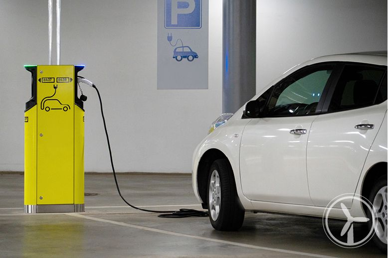 electric-car-plugged-into-charging-station-in-parking-garage-in-page