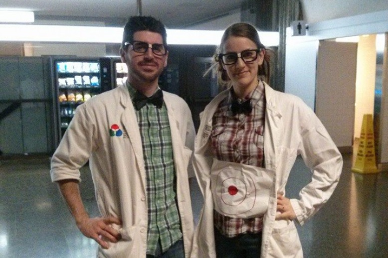Lianne Manzer with partner in lab coats
